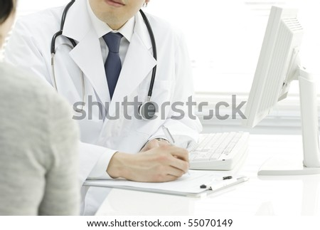 Doctor who hears patient's speaking - stock photo