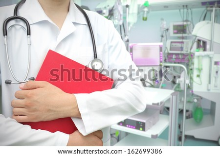 doctor with a book in the ICU. - stock photo