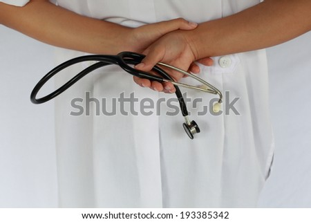 Doctor with a stethoscope in the hands behind the back  - stock photo