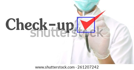 doctor with a stethoscope with the word Check-up  written in it - stock photo