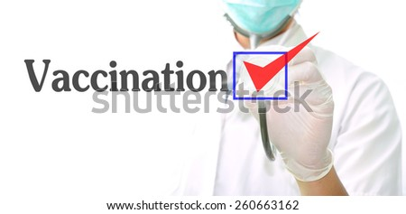 doctor with a stethoscope with the word vaccination written in it - stock photo