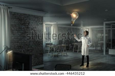 Doctor with bulb balloon . Mixed media - stock photo