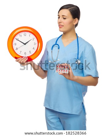 Doctor with clock and pills isolated - stock photo