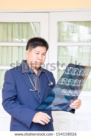 doctor with CT scan film for diagnosis - stock photo