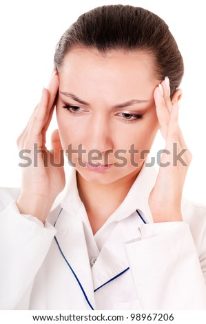 Doctor with headache isolated on white background - stock photo