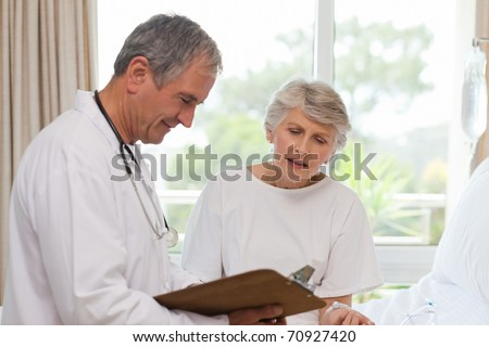 Doctor with his patient - stock photo