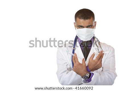 Doctor with mask holding a swine flu injection in his ands and looks into camera. Isolated on white. - stock photo