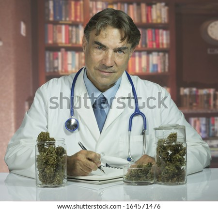 Doctor with medical marijuana - stock photo