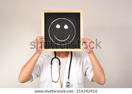 Doctor with smiling face in blackboard