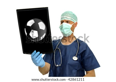 Doctor with soccer ball x-ray isolated in white - stock photo