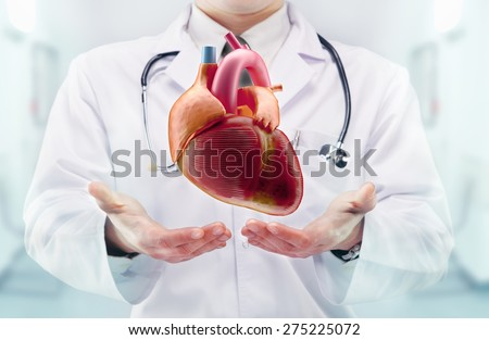 Doctor with stethoscope and heart on the  hands in a hospital. High resolution.  - stock photo