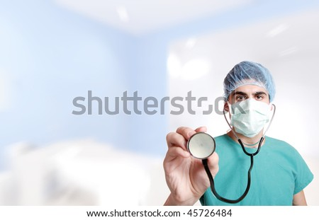 Doctor with stethoscope in emergency room lighting environment selective focus - stock photo