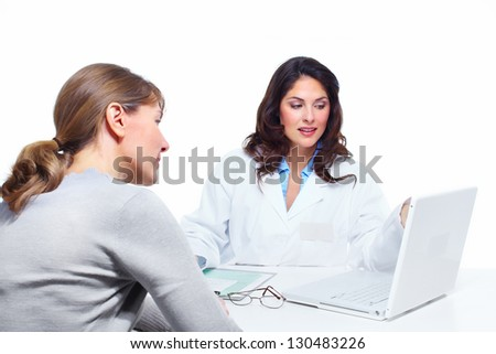 Doctor woman and patient. Health care clinic. - stock photo