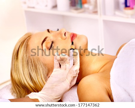 Doctor woman giving injections. Isolated. - stock photo