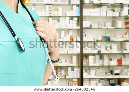 doctor woman in drug store - stock photo
