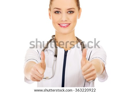 Doctor woman showing thumbs up. - stock photo