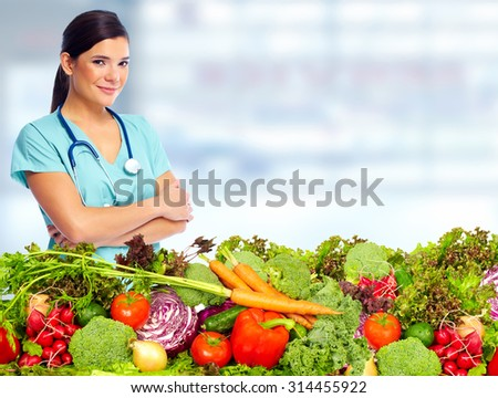 Doctor woman with vegetables. Healthy diet and nutrition. - stock photo