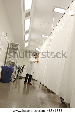 Doctor working at a hospital room, medical image - stock photo