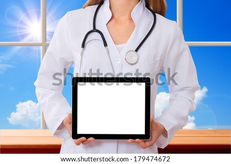 Doctor working with tablet, closeup.