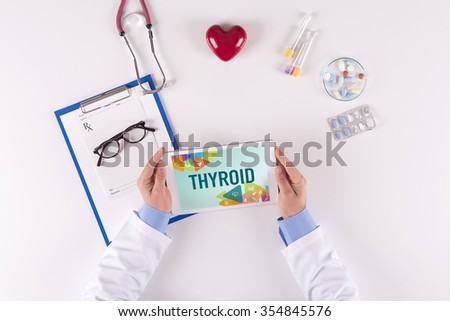 Doctor workplace with THYROID on tablet - stock photo