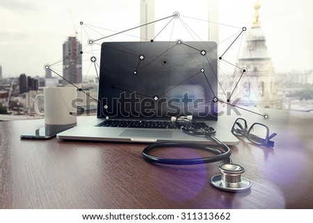 Doctor workspace with laptop computer in medical workspace office and medical network media diagram as concept - stock photo