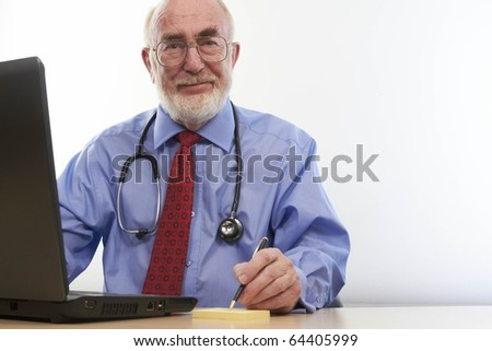 Doctor writing notes - stock photo
