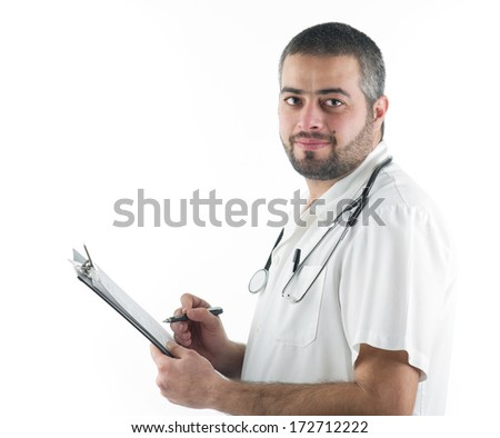 Doctor writing notes to a patient's folder isolated on white - stock photo