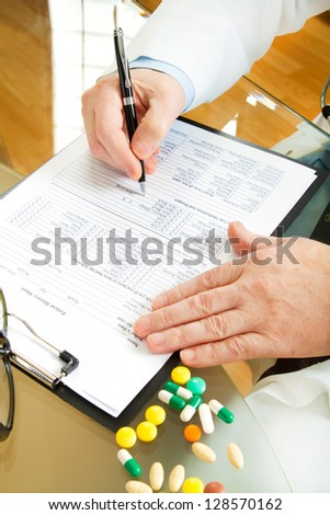 Doctor writing prescription selective focus - stock photo