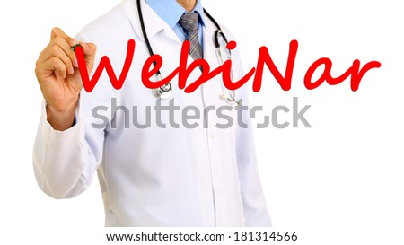 Doctor writing word Webinar on transparent board - stock photo