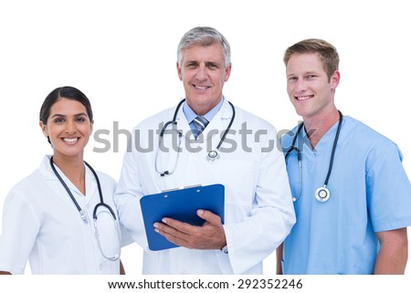 Doctors and nurses discussing over notes on a white background
