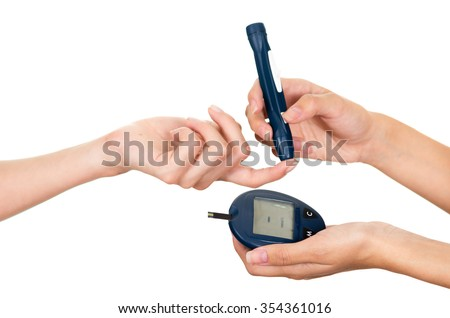 Doctors arm holding glucose meter scanner on patients finger and measure monitor in other hand. - stock photo