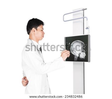 Doctors examining skull x-ray, isolated on white background - stock photo