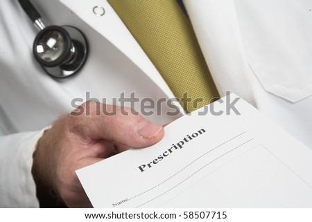 Doctors hand holding prescription - stock photo