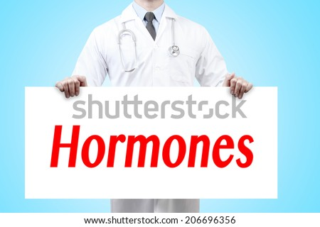doctors holding a white banner have word hormones sign  - stock photo