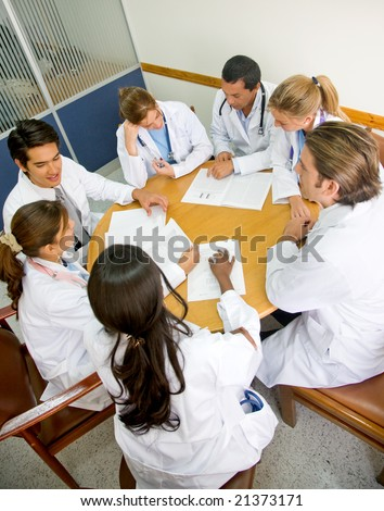doctors in a hospital having a meeting - stock photo
