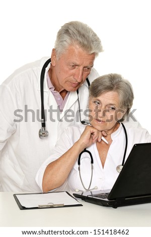 Doctors in a white coat with a stethoscope working with laptop - stock photo