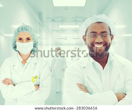 Doctors in hospital - stock photo