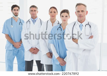 Doctors looking at the camera with folded arms - stock photo