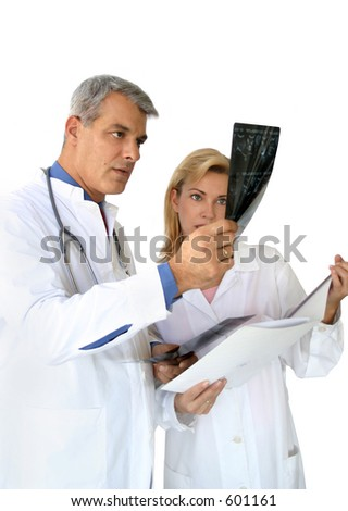 Doctors looking at x-rays