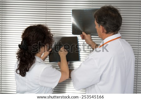Doctors looking for xray's patient - stock photo