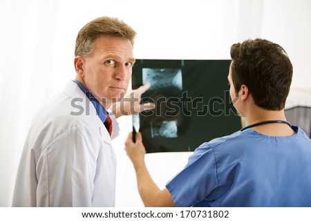 Doctors: Reviewing an X-Ray - stock photo