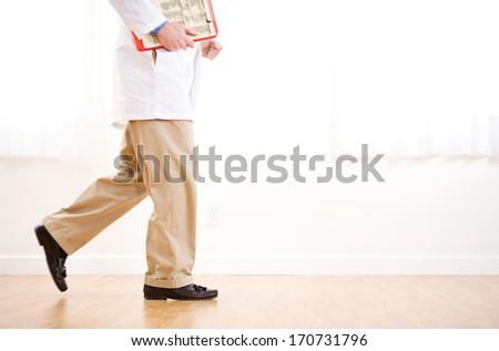 Doctors: Running Doctor in Hallway - stock photo