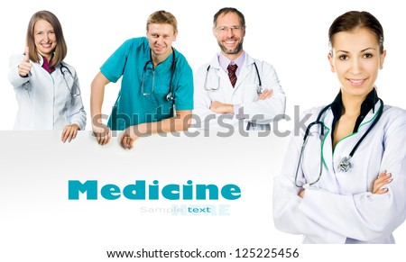 doctors showing clipboard with copy space for text or design - stock photo
