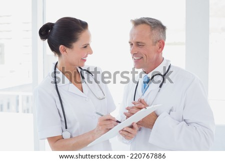 Doctors smiling and working together at work