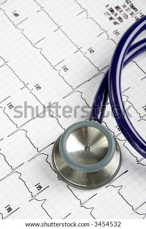Doctors stethoscope on top of an EKG - stock photo