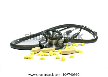 Doctors Stethoscope With Medical Drugs - stock photo