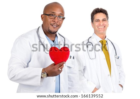 Doctors team posing with a big red heart - stock photo