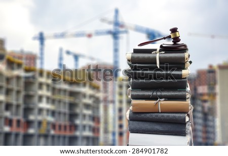 Document files with gavel on buildings under construction - stock photo