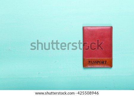 document identity passport lying on a wooden turquoise surface, space for text, top view - stock photo
