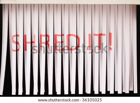 Document with words shred it written in red, being shredded - stock photo